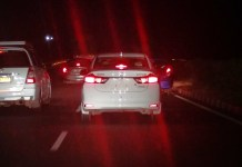 A Car Plying on Highway without Number Plate