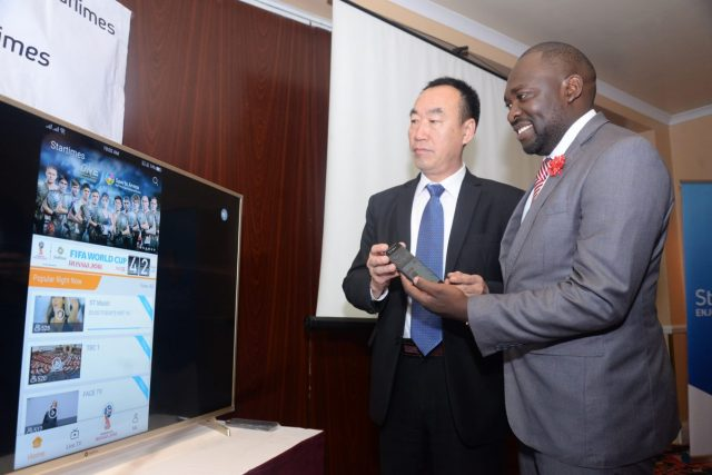 StarTimes Director of Marketing and PR Mr. Japhet Akhulia (right) is joined by the company's Chief Executive Officer Mr. David Zhang (left) in demonstrating how the StarTimes mobile application works