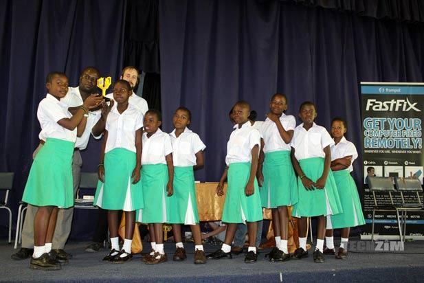 Orange, the team from Gombo Primary School