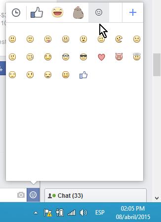 Botón de la carita que muestra los emoticones en cómo hacer caritas en los mensajes de Facebook