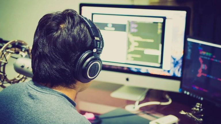 selective focus photography of man facing computer