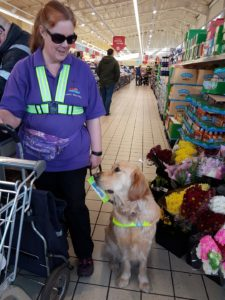 Teddy and Ma looking at each other in the aisle of Aldi