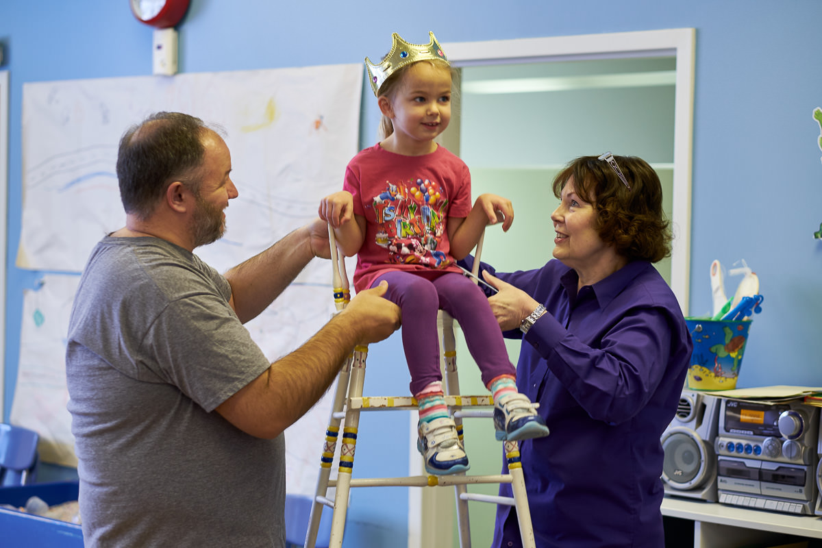 The birthday tradition at the preschool is to put the birthday child in the birthday chair and then lift them up the number of their age. This was the only time she smiled in the chair.