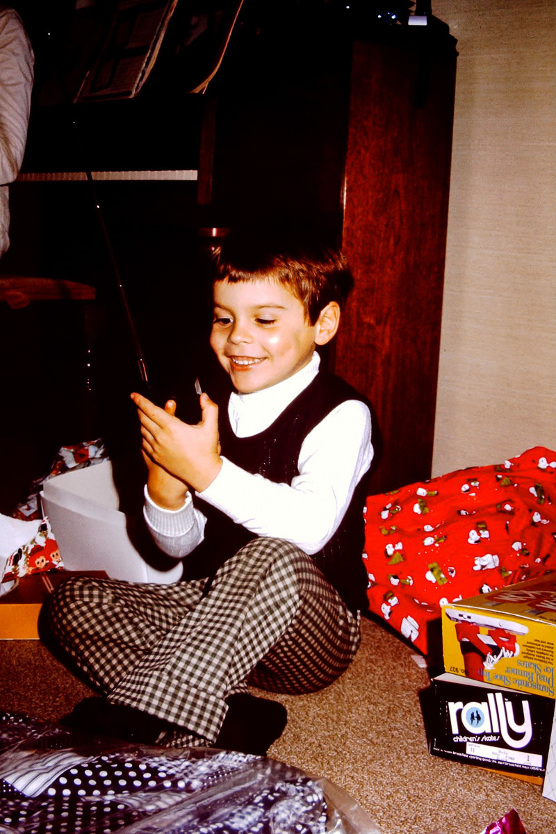 Christmas 1973: Dickey is excited about a radio or walkie-talkie toy