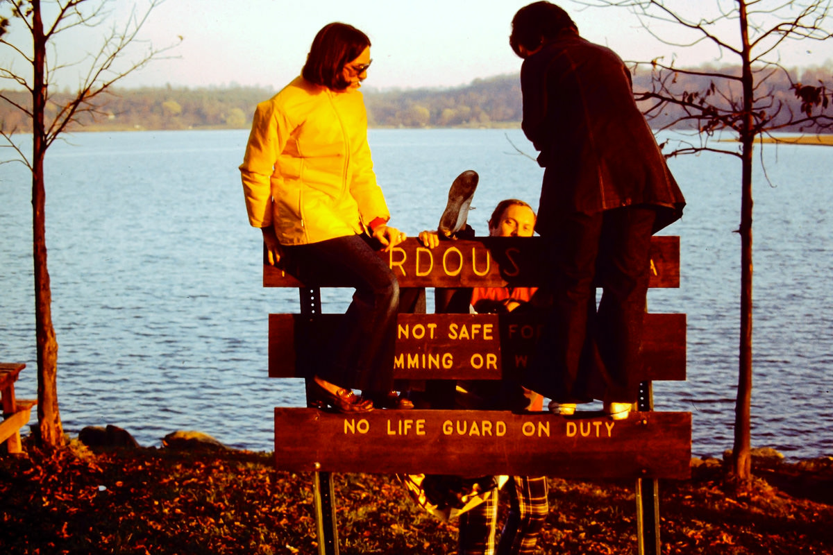 1974: Jan & Mary Lou on the sign. You have to look closely for Sandy, but that's her foot as Jim lifts her up to join them