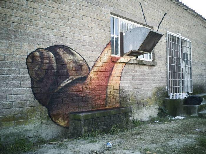 Artista sul-africano pinta grafites incríveis que interagem com o ambiente (32 fotos) 2