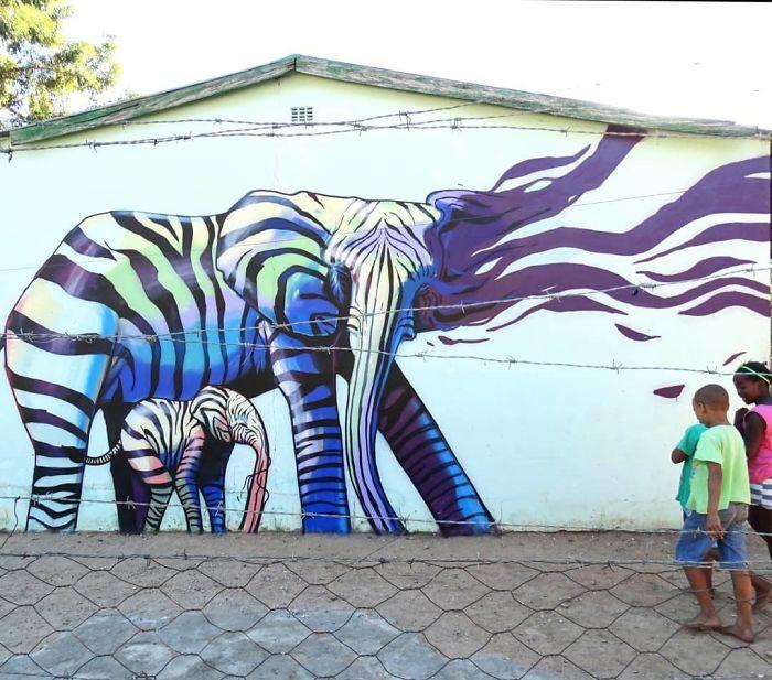 Artista sul-africano pinta grafites incríveis que interagem com o ambiente (32 fotos) 8