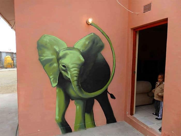 Artista sul-africano pinta grafites incríveis que interagem com o ambiente (32 fotos) 10