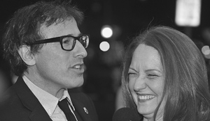 Mr. Russell shares a laugh with actress Melissa Leo on the red carpet.