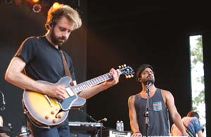 "Young the Giant rode the success of their second album ""Mind Over Matter"" to an appreciative Bowl crowd on Thursday. Guitarist Jacob Tilley, left, and vocalist Sameer Gadhia, right, lead this five-piece alternative rock group out of Irvine."