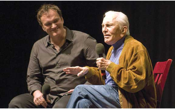 """Quentin Tarantino and Kirk Douglas ask each other questions in front of the crowd after the showing of """"Posse"""" at the Lobero Theater. ROBBY BARTHELMESS/NEWS-PRESS"""