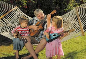 """Jim Clark's fraternal twins, Tristan and Eva, 5, inspired him to pursue music. He recently released """"Ukulele Jim's Jumping Flea Circus,"""" a CD for kids featuring ukulele tunes. STEVE MALONE/NEWS-PRESS"""