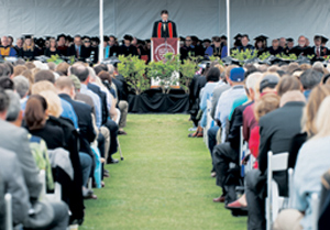 Alister Chapman, associate professor of history, gives the invocation Saturday at Westmont College's commencement. KENNETH SONG/NEWS-PRESS