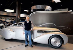 """Peter Mullin of the Mullin Automotive Museum in Oxnard stands with a 1938 Bugatti Dubonnet Hispano-Suiza H6C """"Xenia."""" Mr. Mullin is leading a renovation of the Petersen Automotive Museum in Los Angeles. HELENA DAY BREESE/NEWS-PRESS"""