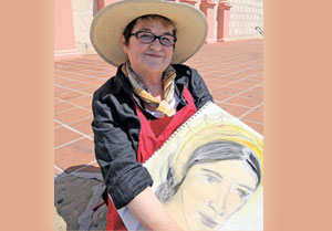 Blair Looker, featured artist of this year's I Madonnari Italian Street Painting Festival, holds one of her sketches that will be created in chalk at the Santa Barbara Mission next weekend. HELENA DAY BREESE/NEWS-PRESS