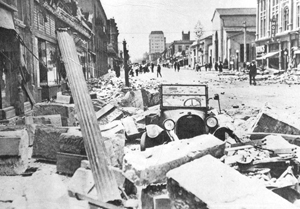 Devastation left in the wake of a June 29, 1925, earthquake is evident in this view looking up State Street to the Granada Theatre in the center. NEWS-PRESS FILE PHOTOS
