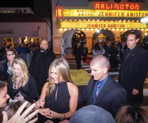 Jennifer Aniston signs autographs for fans outside the Arlington Theatre on Friday night, before receiving the Santa Barbara International Film Festival's Montecito Award. NIK BLASKOVICH/NEWS-PRESS PHOTOS
