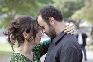 Siham (Reymond Amsalem) and Amin (Ali Suliman) embrace Cohen Media photo