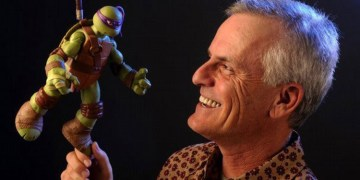 Rob Paulsen holding up a Donatello toy. Image Source: Nickelodeon, Playmates Toys.