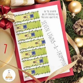 Blank Christmas card or invitation with red envelope surrounded by ribbons and decorations. Space for copy.