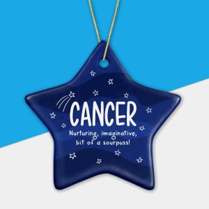 """Blue and white bauble with star pattern and cancer constellation with the phrase """"Nurturing, imaginative, bit of a sourpuss!"""""""