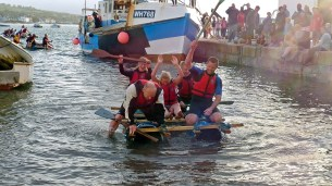 Teignmouth Regatta raft race. The Coastguard win the race