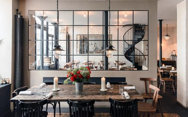 The look here is distressed bistro casual and industrial lighting