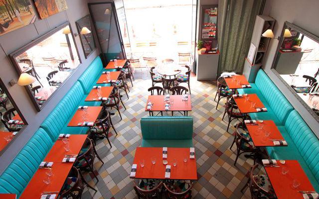 Au Rendez-vous des Camionneurs has colourful banquettes and a few seats outside