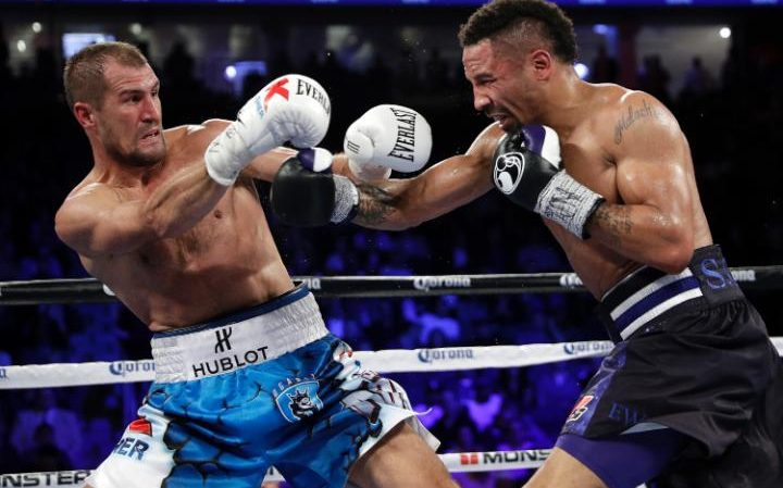 Sergey Kovalev backs away from a punch from Andre Ward