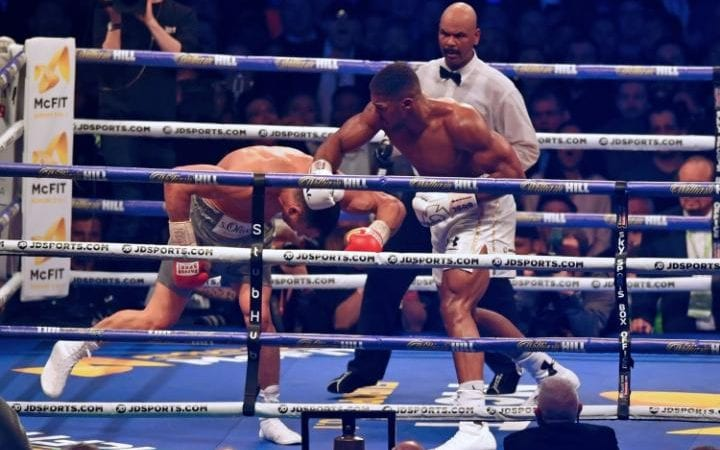 After the uppercut, Joshua caught him on the way down with a right-hander