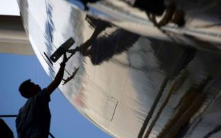 man working on the side of an aeroplane