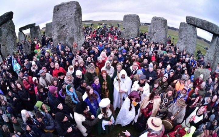 People gather at Stonehenge in Wiltshire on the winter solstice to witness the sunrise on the shortest day of the year