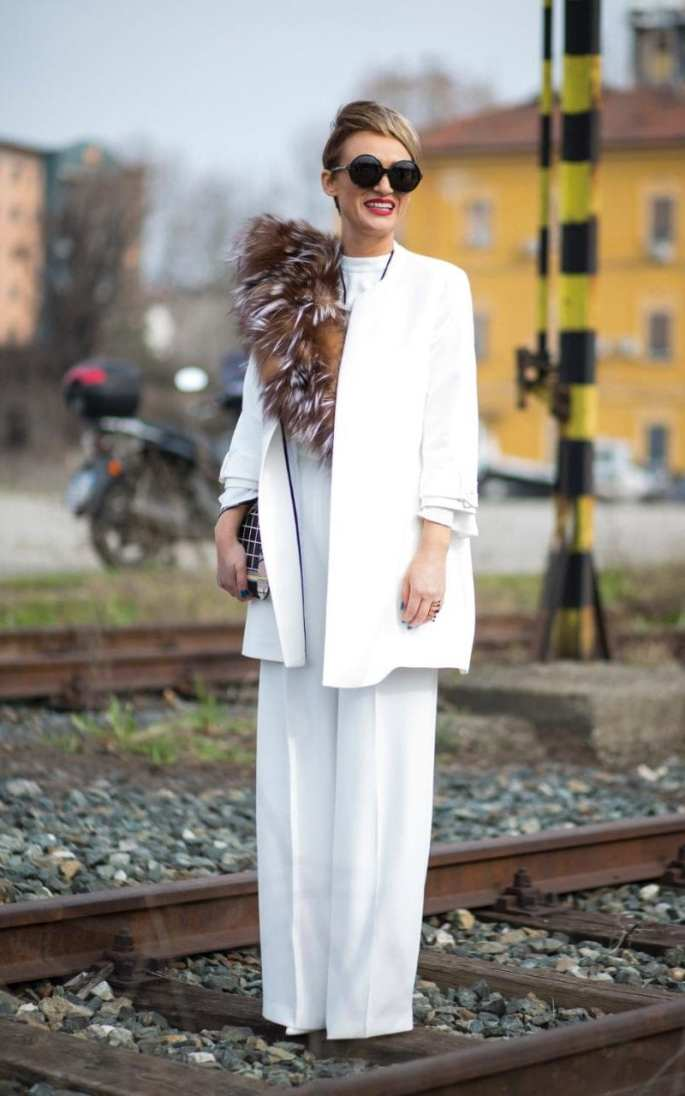 An all-white outfit is always elegant (if prone to becoming less than pristine), but a fluffy stole adds sophistication while breaking up a block colour