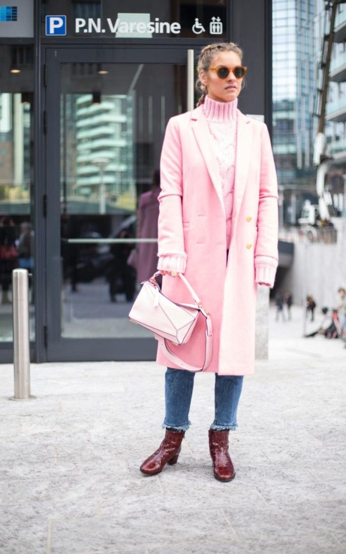 Matching your cable knit sweater to your tailored coat and Loewe Puzzle bag is no mean feat, especially when they're all in strawberry milkshake pink harmony. A pair of frayed cuff jeans and raspberry jam patent boots ground the look