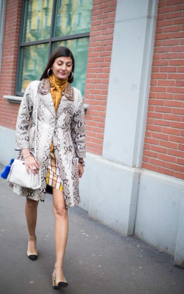 Treat snakeskin as a neutral, likeGiovanna Battaglia, and pair it with a mustard yellow printed scarf and co-ordinating geometric skirt. A sassy pair of giant hoops and Chanel two-tone loafers completes the chic European holidaymaker look