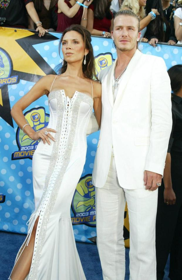 Anothe rmatchy-matchy moment with David at the MTV Awards in 2003. Victoria has faithful to Dolce & Gabbana's statement lace-up dresses at that time
