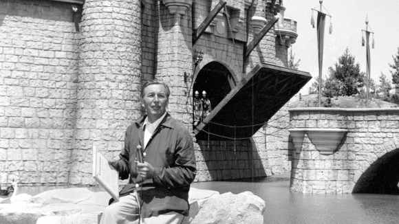 Walt Disney in front of the Sleeping Beauty Castle in the Fantasyland section of Disneyland on opening day of the amusement theme park in Anaheim, California on July 17, 1955.
