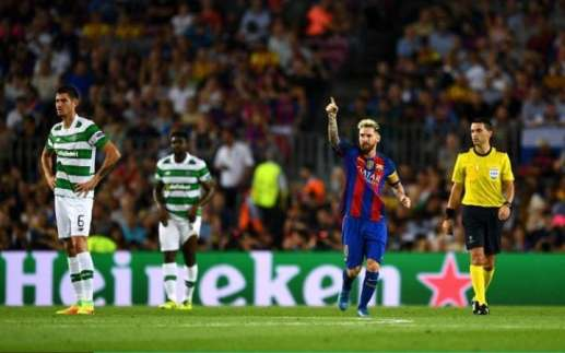 Lionel Messi of Barcelona celebrates scoring his sides first goal