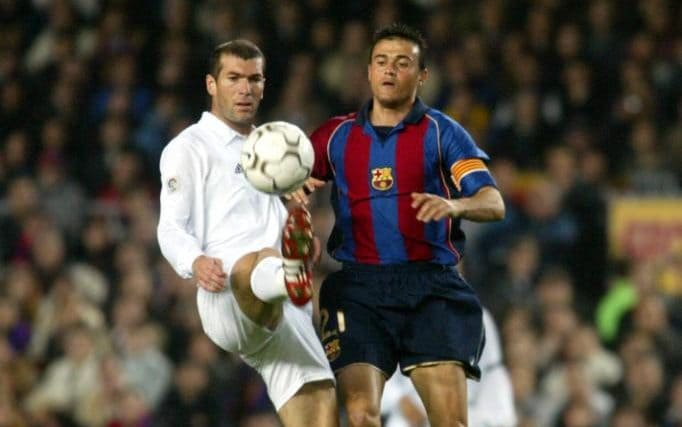 Zinedine Zidane of Real Madrid and Luis Enrique of Barcelona in action