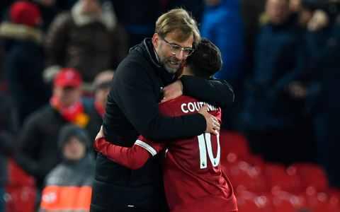 Jurgen Klopp hugs Philippe Coutinho