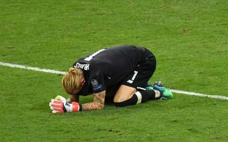 Loris Karius, who was at fault for two Real Madrid goals, covers his tears at the final whistle