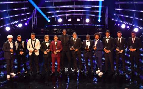 Presenter Former Brazil and Barcelona player Ronaldinho, Brazil and PSG defender Dani Alves, Real madrid and Spain defender Sergio Ramos, Real Madrid and Croatia midfielder Luka Modric, Chelsea and Belgium midfielder Eden Hazard, British actor and event host Idris Elba, Paris Saint-Germain and France forward Kylian Mbappe and Chelsea and France midfielder NGolo Kante, Brazil's defender Marcelo, France and real Madrid defender Raphael Varane, Manchester United and Spain goalkeeper David De Gea and presenter former Germany captain Michael Ballack with their trophies