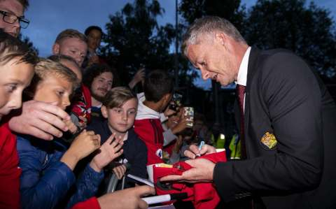 Ole Gunnar Solskjaer, Manager of Manchester United signs autographs after the Pre-Season Friendly match between Kristiansund BK and Manchester United at Ullevaal Stadion