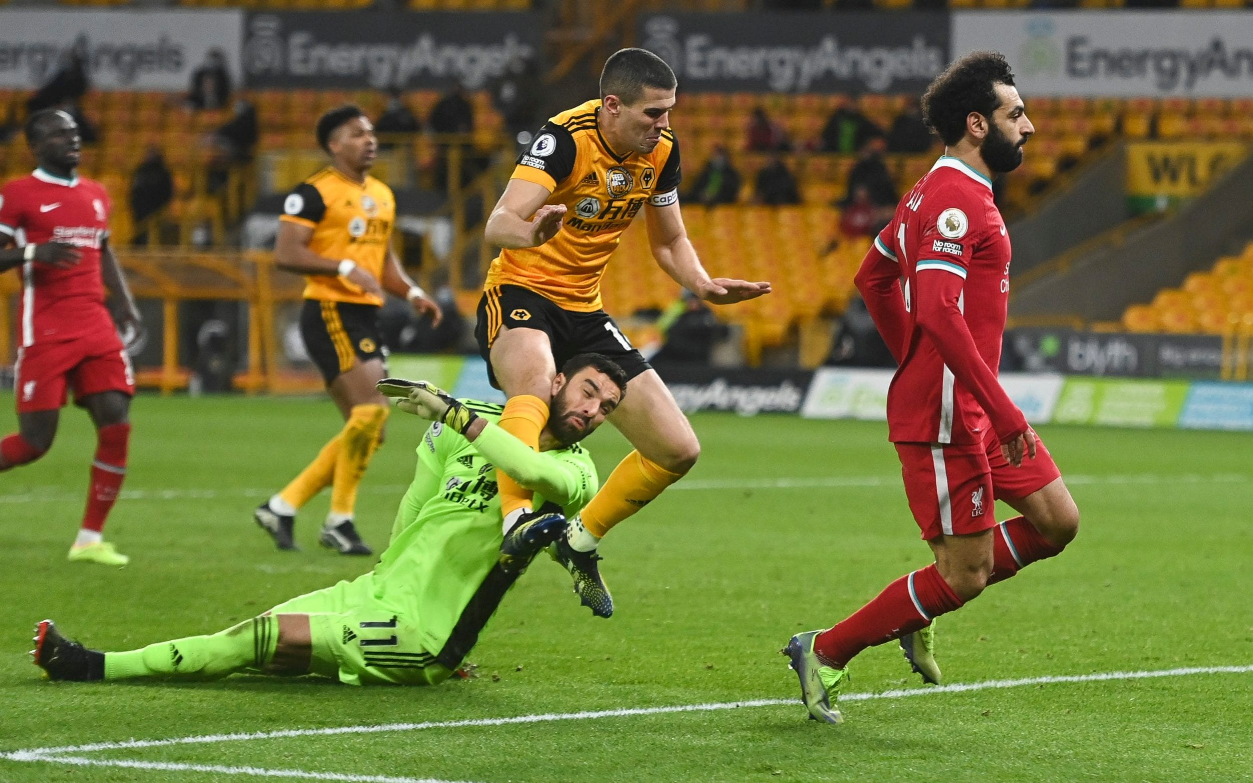 Conor Coady of Wolverhampton Wanderers collides with his own goalkeepr Rui Patricio as Mohamed Salah of Liverpool scored but was ruled off for offside