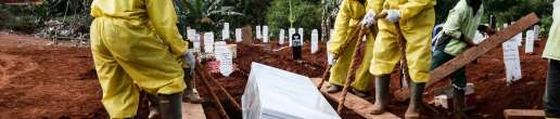 Funeral workers wearing protective suits bury a coffin of coronavirus victim at Pondok Ranggon cemetery in Jakarta, Indonesia on September 9, 2020. The cemetery of Pondok Ranggon is almost full as Jakarta's administration recorded more than 5,000 bodies buried with Covid-19 protocols.