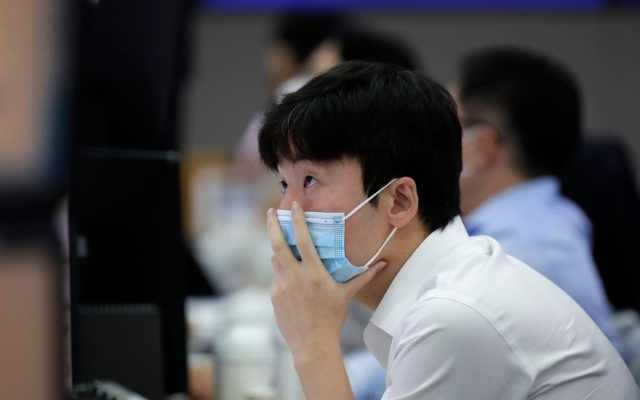 A currency trader watches computer monitors at the foreign exchange dealing room in Seoul, South Korea, Thursday, Sept. 10, 2020. Asian stock markets gained Thursday after Wall Street rebounded from a three-day slump for tech stocks.