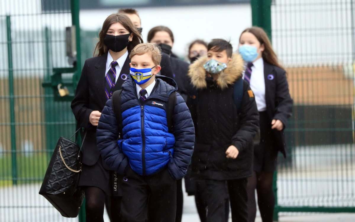 Children arrive at Outwood Academy in Woodlands, Doncaster in Yorkshire