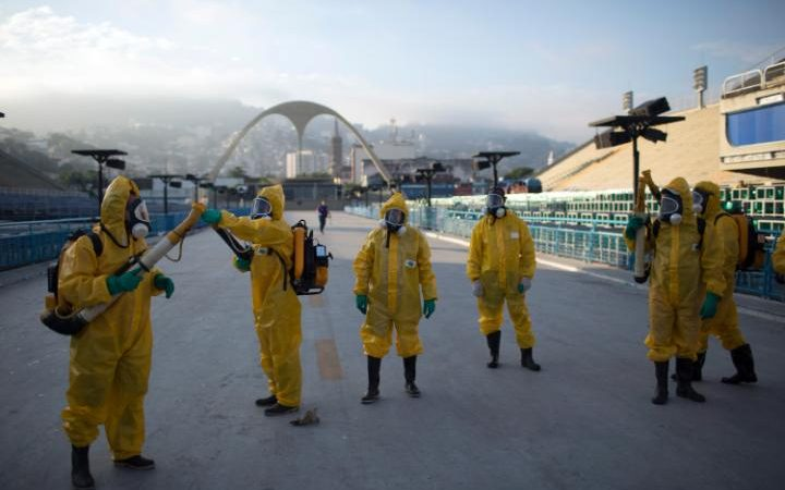 Health workers in Brazil get ready to spray insecticide to combat the Aedes aegypti mosquitoes that transmits the Zika virus