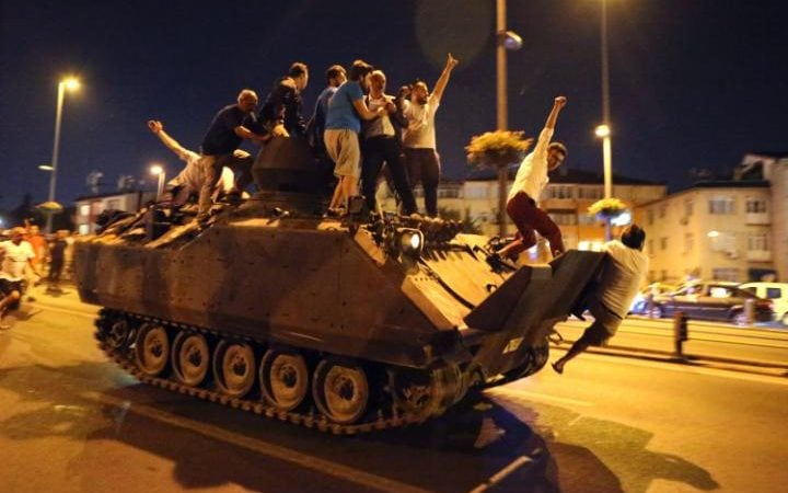 Protesters stand on an armoured vehicle in Istanbul.