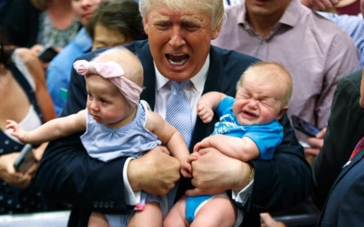Republican presidential candidate Donald Trump holds Kellen Campbell of Denver, right, and Evelyn Keane, of Castle Rock, Coloradoduring a campaign rally in Colorado Springs.